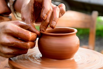 Clay Potter who is making pots for cooking